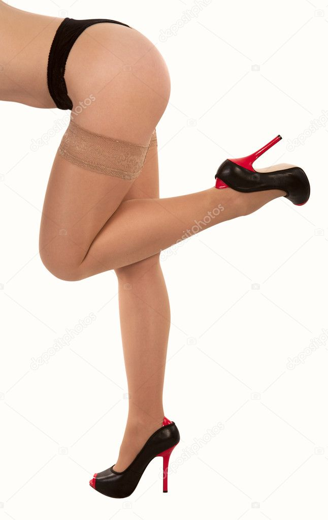 Harmonous legs  of the girl in stockings of corporal color on a white background — Stock Photo #2455621