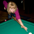 Stock Photo: Girl playing pool