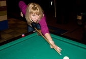 Girl playing pool — Stock Photo