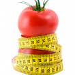 Tomato and measuring tape diet concept - Stock Photo
