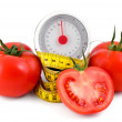 Tomato and measuring tape — Stock Photo
