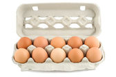 Eggs in protective case foreground — Stock Photo
