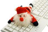 Santa claus in keyboard — Stock Photo