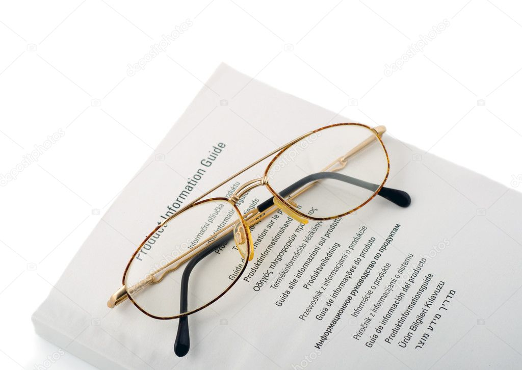 Spectacles in book instruction isolated on white background — Stock Photo #1191742