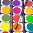 Stock Photo: Paints and paintbrush