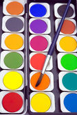 Paints and paintbrush — Stock Photo