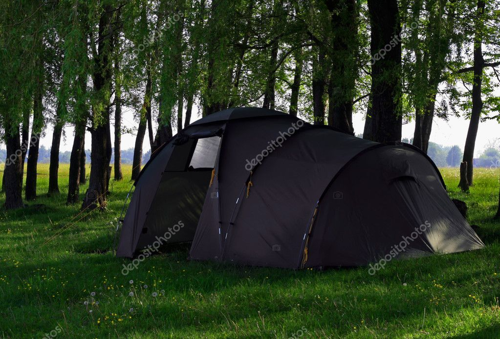 Green camping tent on green grassbackground — Stockfoto #1208372