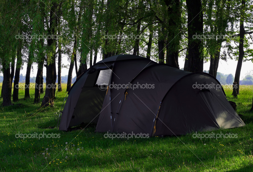 Green camping tent on green grassbackground — Стоковая фотография #1208372
