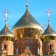 Shining golden onion domes - Stock Photo