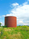 Iron cistern on the field — Stock Photo