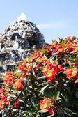 Fountain with beautiful flowers — Stock Photo
