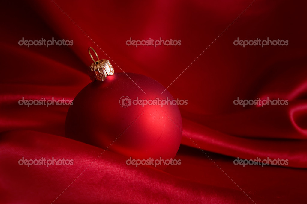 Christmas card with red ornament on the satin  Stock Photo #1149747
