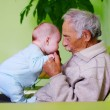 Stock Photo: Baby with grandpa