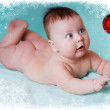Baby with christmas ornament — Stock Photo
