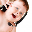 Baby with headset - Stock Photo