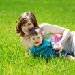 Mother and son on the grass — Stock Photo