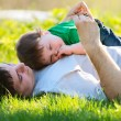 Stock Photo: Father and son on the grass