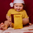 Baby in red hat - Stock Photo