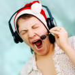Royalty-Free Stock Photo: Yawning christmas operator