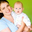 Mother hugs her baby — Stock Photo
