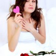 Girl in bed with valentine — Stock Photo