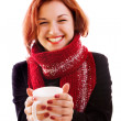Girl in winter clothes with cup — Stock Photo