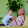 Baby with grandpa — Stock Photo #1179954