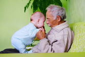 Baby with grandpa — Stock Photo