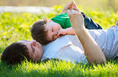 Father and son on the grass — Stock Photo