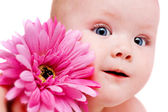 Baby girl with flower — Stock Photo