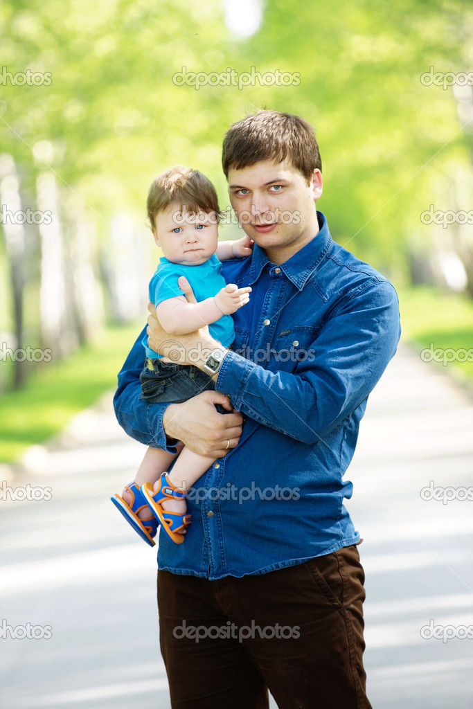 Portrait of happy father and son in the park  Stock Photo #1173553