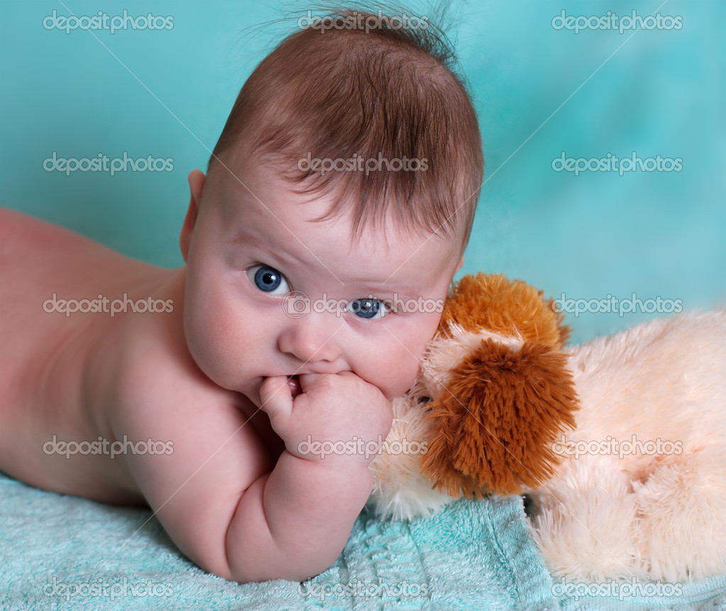 Portrait of baby on blue background — Stock Photo #1174125