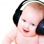 Baby in earphones — Stock Photo