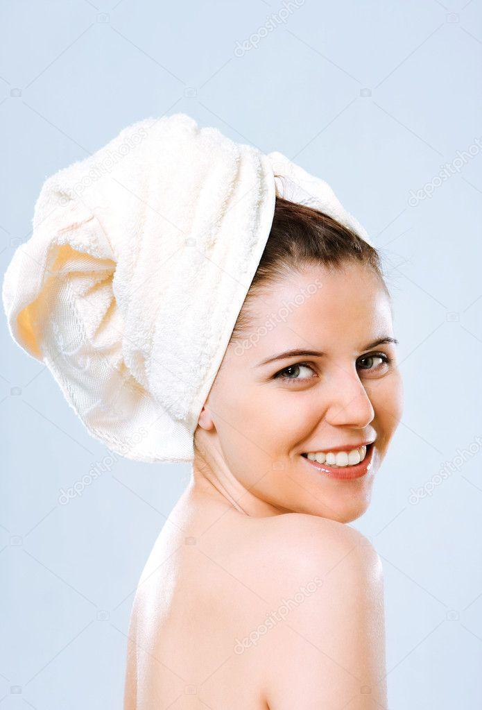 Beautiful young woman with towel on the head — Stock Photo #1575763
