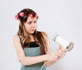 Girl with hairdryer — Stock Photo