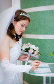 Bride signing documents — Stock Photo