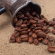 Cezve and coffee beans closeup view - Stock Photo