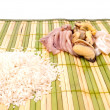 Rice and seafood on bamboo mat — Stock Photo