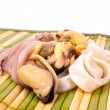 Seafood on bamboo mat — Stock Photo