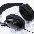 Headphones and notes - Stock Photo