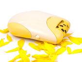 Epilator and yellow petals — Stock Photo