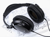 Headphones and notes — Stock Photo