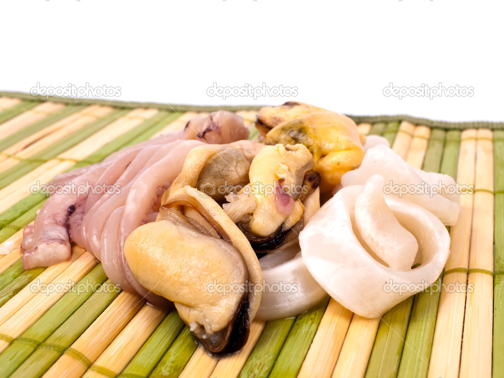Seafood on bamboo mat, closeup view — Stock Photo #1177877