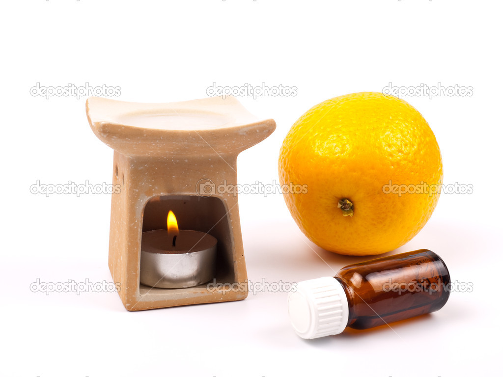 Aroma lamp with citrus oil and citrus isolated on white — Lizenzfreies Foto #1178011