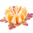 Royalty-Free Stock Photo: Sliced tangerine and leaves