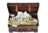 Full of money wooden chest — Stockfoto