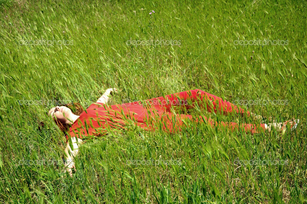Young girl laying on green grass   Stock Photo #1215377