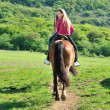 Stock Photo: Teenage girl on horse