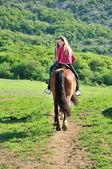 Teenage girl on a horse — Stock Photo