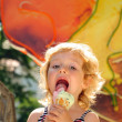Little girls like an ice cream — Stock Photo